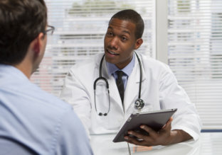 Young African American doctor consulting with patient, horizontal