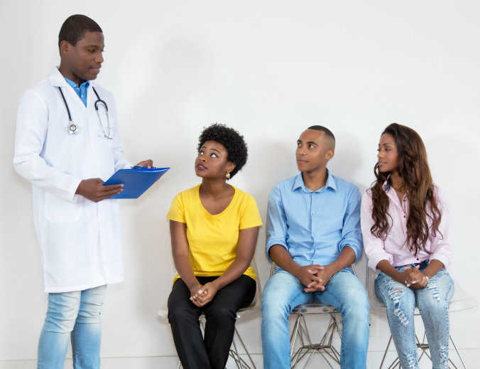 three patients looking at the doctor