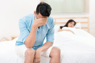 man unhappy and disappointed in the erectile dysfunction during sex