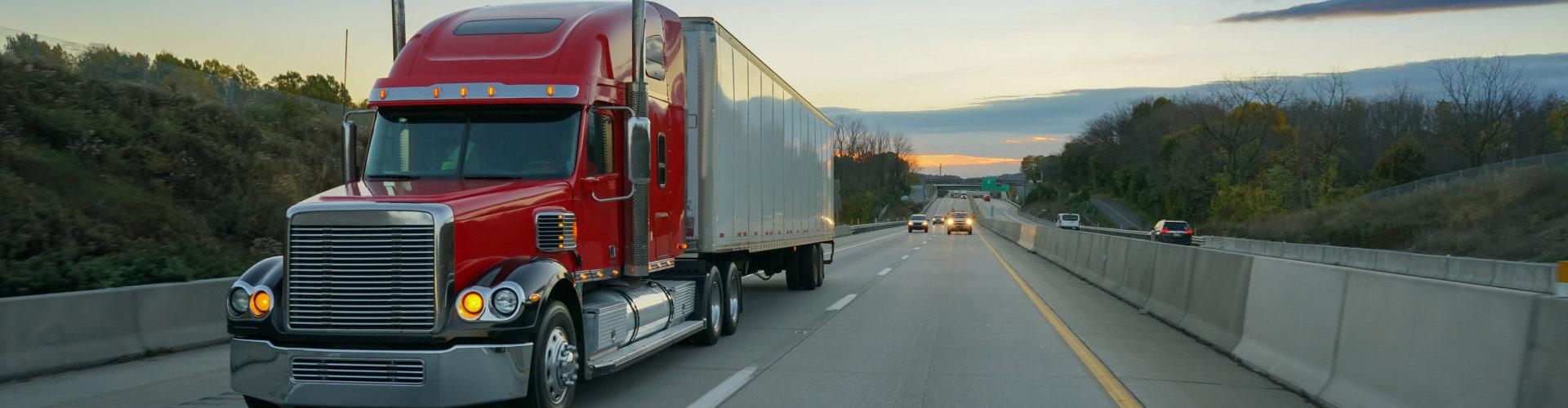 Big red semi truck on highway