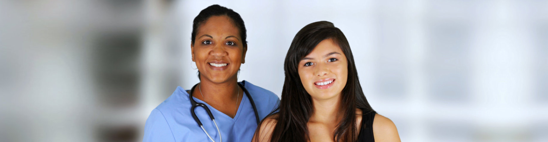 nurse and young lady smiling