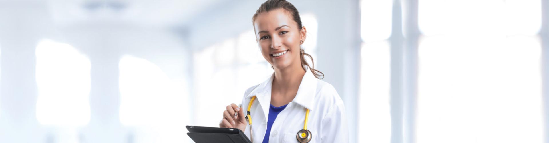 nurse with yellow stethoscope smiling