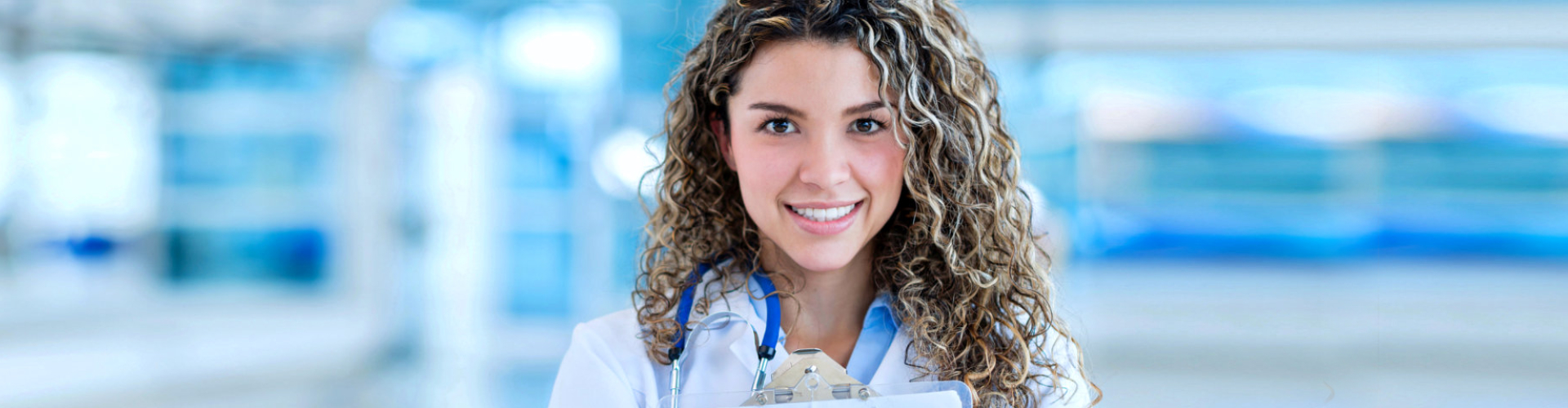 nurse with blonde and curly hair smiling